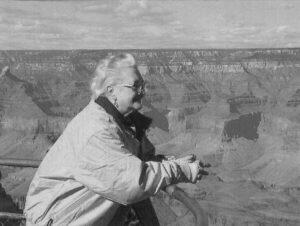 an old lady at the edge of the grand canyon